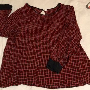 Red and black patterned blouse